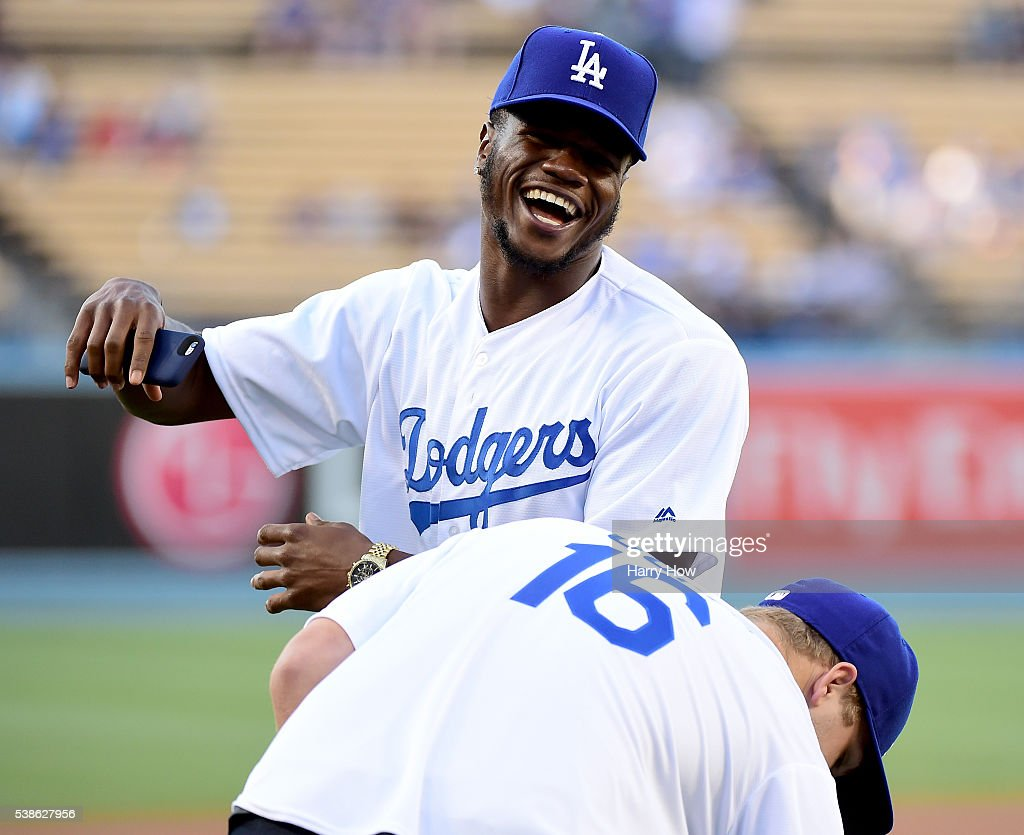 Michael Thomas and Jared Goff of the Los Angeles Rams laugh on the field before the game between the Colorado Rockies and the Los Angeles Dodgers at Dodger Stadium on June 6, 2016 in Los Angeles, California.