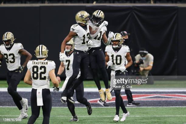 Michael Thomas of the New Orleans Saints and Alvin Kamara react following a third quarter touchdown against the Atlanta Falcons at Mercedes-Benz...