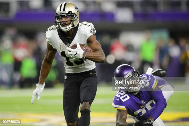 Michael Thomas of the New Orleans Saints carries the ball against Ken Crawley of the New Orleans Saints during the game of the NFC Divisional Playoff...