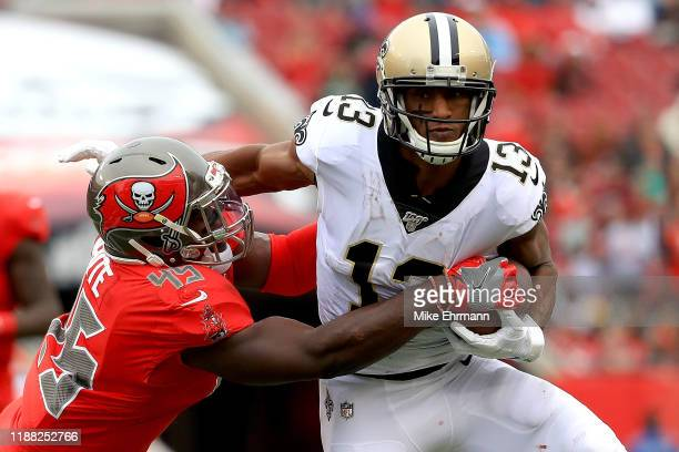 Michael Thomas of the New Orleans Saints carries the ball against Devin White of the Tampa Bay Buccaneers at Raymond James Stadium on November 17...