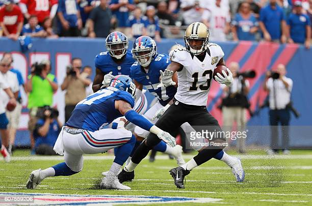 Michael Thomas of the New Orleans Saints carries the ball against Darian Thompson of the New York Giants during the first half at MetLife Stadium on...