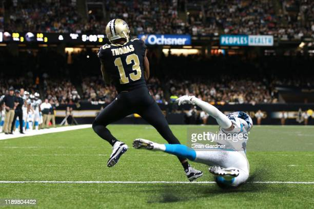 Michael Thomas of the New Orleans Saints catches a 3 yard touchdown pass from Drew Brees against the Carolina Panthers during the third quarter in...