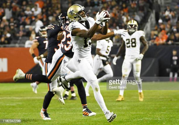 Michael Thomas of the New Orleans Saints catches a pass as Kyle Fuller of the Chicago Bears defends him during the second half at Soldier Field on...