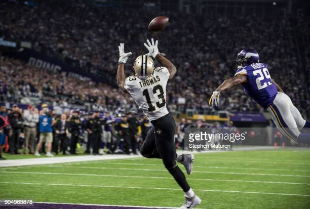 Michael Thomas of the New Orleans Saints catches the ball for a touchdown over defender Xavier Rhodes of the Minnesota Vikings in the third quarter...