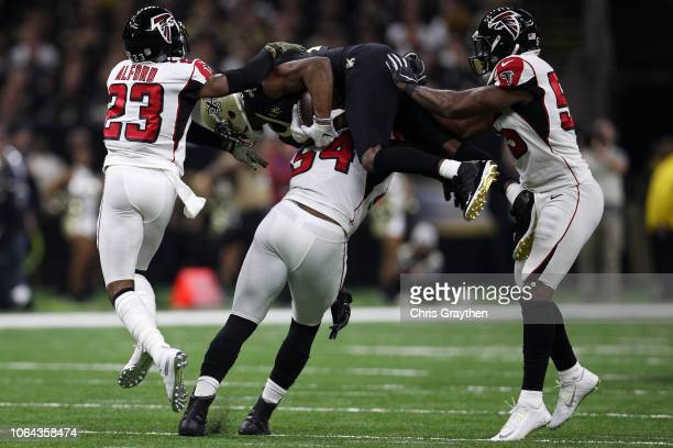 Michael Thomas of the New Orleans Saints catches the ball over Deadrin Senat of the Atlanta Falcons at the MercedesBenz Superdome on November 22 2018...