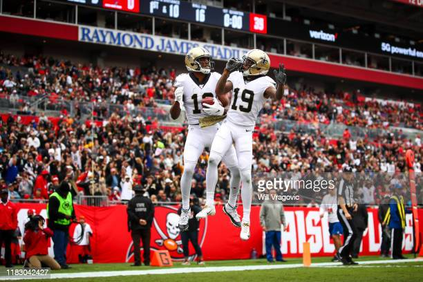Michael Thomas of the New Orleans Saints celebrates after a touchdown with Ted Ginn in the first quarter of the game against the Tampa Bay Buccaneers...