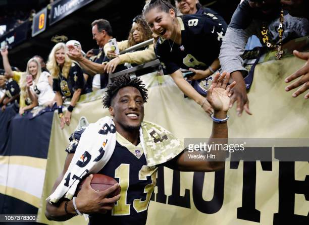 Michael Thomas of the New Orleans Saints celebrates with fans after his team defeated the Los Angeles Rams 4535 in the game at MercedesBenz Superdome...