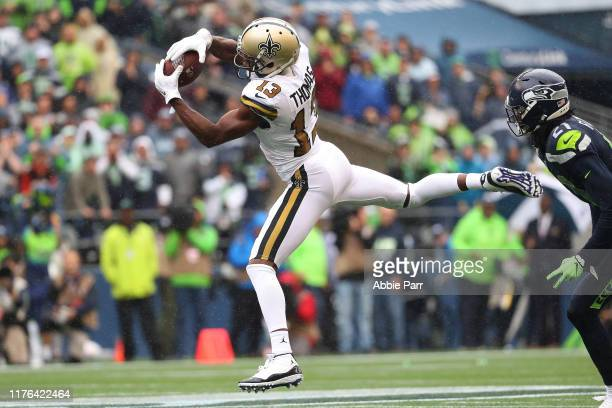 Michael Thomas of the New Orleans Saints completes a pass in the second quarter against the Seattle Seahawks during their game at CenturyLink Field...