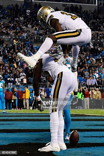 Michael Thomas of the New Orleans Saints hurdles Brandon Coleman in celebration after Coleman made a touchdown reception against the Carolina...