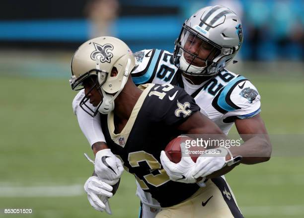 Michael Thomas of the New Orleans Saints is tackled by Daryl Worley of the Carolina Panthers during their game at Bank of America Stadium on...