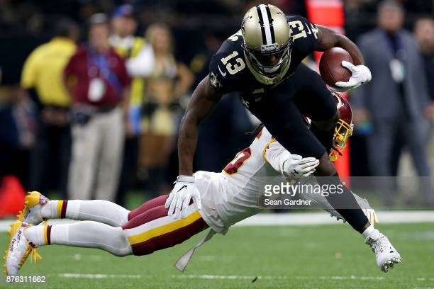 Michael Thomas of the New Orleans Saints is tackled by DJ Swearinger of the Washington Redskins during the first half at the MercedesBenz Superdome...
