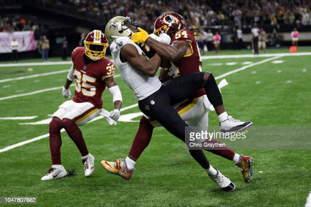 Michael Thomas of the New Orleans Saints is tackled by Mason Foster of the Washington Redskins during the first half at the Mercedes-Benz Superdome...