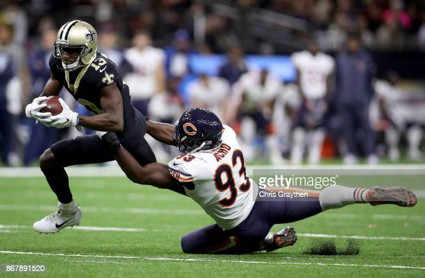 Michael Thomas of the New Orleans Saints is tackled by Sam Acho of the Chicago Bears during the third quarter at the MercedesBenz Superdome on...