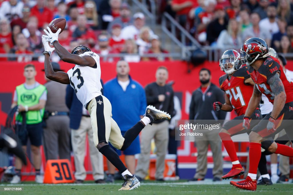 Michael Thomas #13 of the New Orleans Saints makes a 43-yard reception behind the defense in the first quarter of a game against the Tampa Bay Buccaneers at Raymond James Stadium on December 31, 2017 in Tampa, Florida.