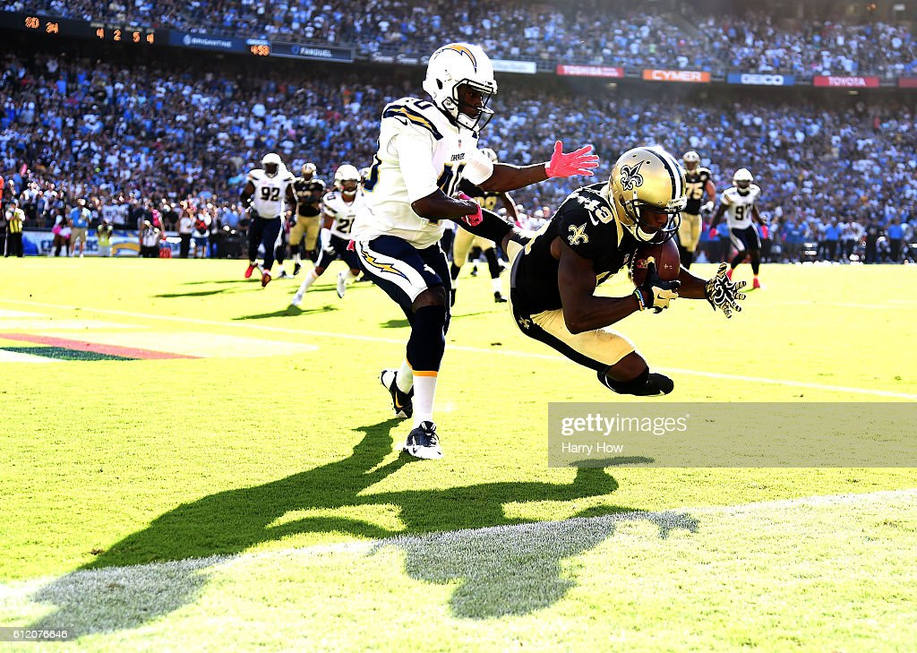Michael Thomas #13 of the New Orleans Saints makes a catch for a touchdown in front of Pierre Desir #40 of the San Diego Chargers to trail 28-34 during the fourth quarter at Qualcomm Stadium on October 2, 2016 in San Diego, California. The Saints came back to win 35-34.
