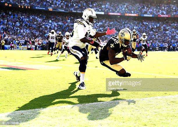 Michael Thomas of the New Orleans Saints makes a catch for a touchdown in front of Pierre Desir of the San Diego Chargers to trail 2834 during the...