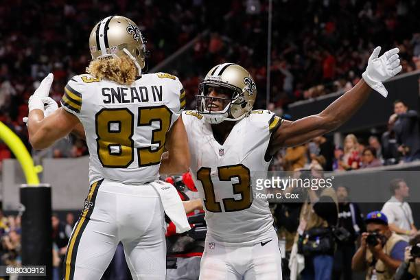 Michael Thomas of the New Orleans Saints reacts after a touchdown reception against the Atlanta Falcons with Willie Snead at MercedesBenz Stadium on...
