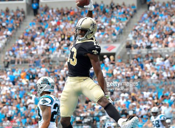 Michael Thomas of the New Orleans Saints reacts after scoring a touchdown against the Carolina Panthers during their game at Bank of America Stadium...