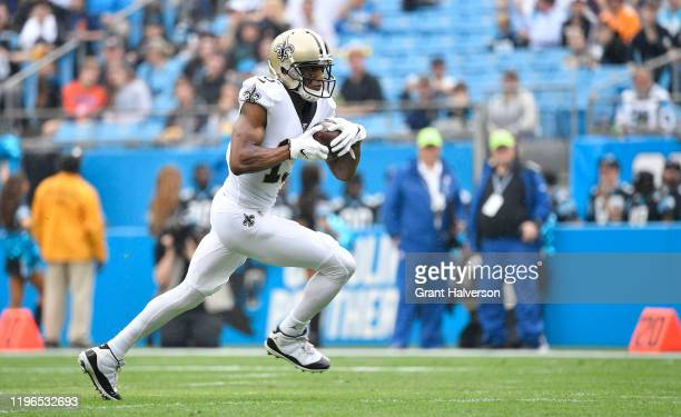Michael Thomas of the New Orleans Saints reaks away from the Carolina Panthers defense during the first quarter of their game at Bank of America...