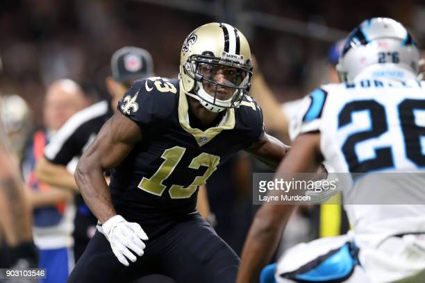 Michael Thomas of the New Orleans Saints runs the ball against Daryl Worley of the Carolina Panthers during the first half of the NFC Wild Card...