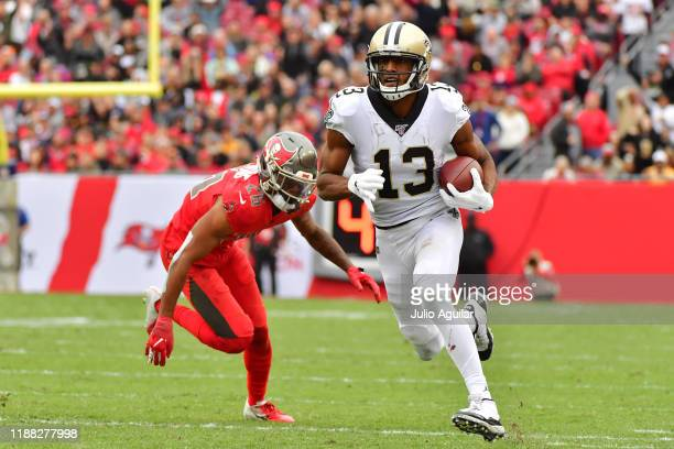 Michael Thomas of the New Orleans Saints runs the ball during the third quarter of a football game against the Tampa Bay Buccaneers at Raymond James...