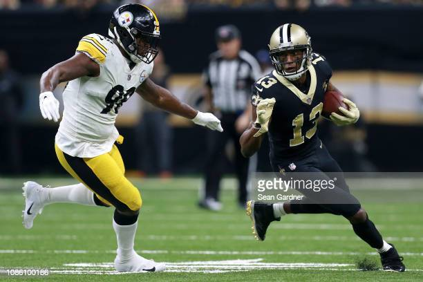 Michael Thomas of the New Orleans Saints runs with the ball as Vince Williams of the Pittsburgh Steelers defends during the first half at the...