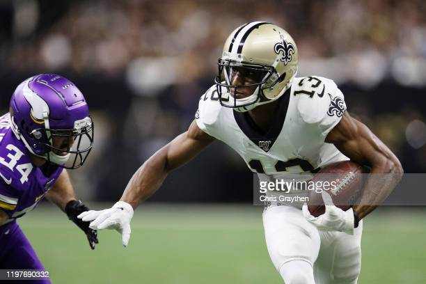 Michael Thomas of the New Orleans Saints runs with the ball during the first half against the Minnesota Vikings in the NFC Wild Card Playoff game at...