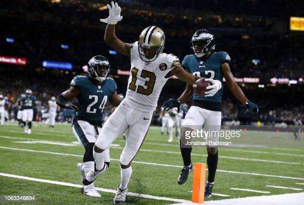 Michael Thomas of the New Orleans Saints scores a touchdown as Corey Graham of the Philadelphia Eagles and Rasul Douglas defends during the second...