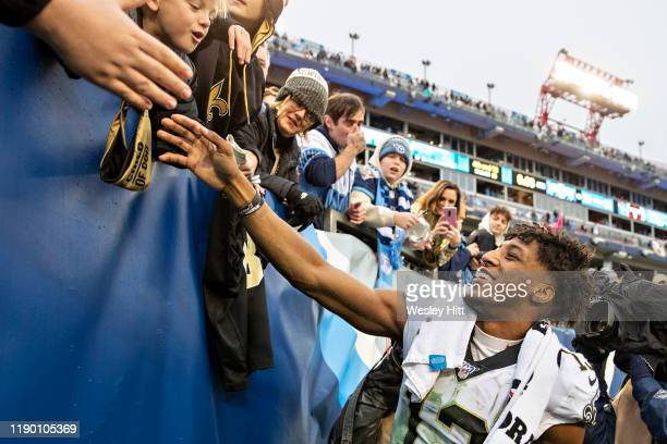 Michael Thomas of the New Orleans Saints shakes hands with fans after a game against the Tennessee Titans at Nissan Stadium on December 22 2019 in...