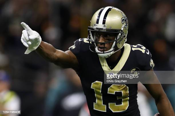 Michael Thomas of the New Orleans Saints signals a first down during the NFC Divisional Playoff at the Mercedes Benz Superdome on January 13 2019 in...