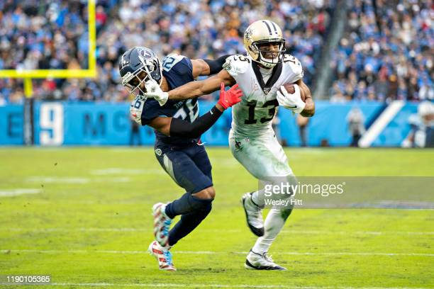 Michael Thomas of the New Orleans Saints stiff arms Logan Ryan of the Tennessee Titans in the second half at Nissan Stadium on December 22 2019 in...