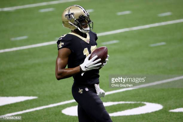 Michael Thomas of the New Orleans Saints warms up ahead of the NFC Wild Card Playoff game against the Chicago Bears at Mercedes Benz Superdome on...