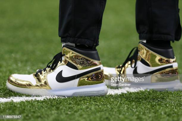 Michael Thomas of the New Orleans Saints wears a pair of Nike shoes during a NFL game against the Atlanta Falcons at the Mercedes Benz Superdome on...