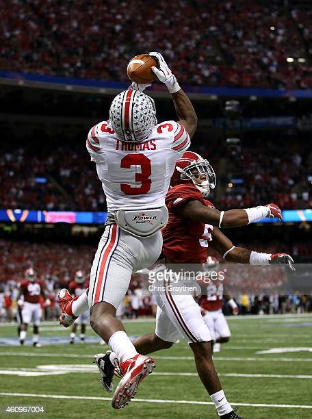 Michael Thomas of the Ohio State Buckeyes catches a 13 yard touchdown pass late in the second quarter against the Alabama Crimson Tide during the All...