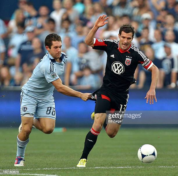 Michael Thomas of the Sporting Kansas City pulls on the shorts of Chris Pontius of the DC United as they battle for the ball in the first half at...