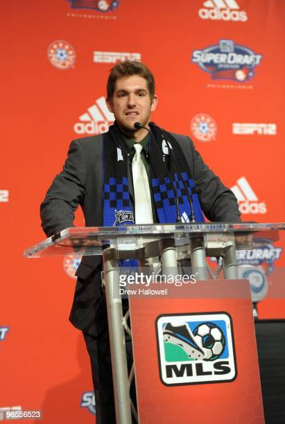 Michael Thomas stands at the podium after being selected by San Jose Earthquakes in the second round during the 2010 MLS SuperDraft on January 14...