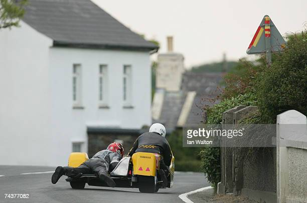 Michael Thompson and Bruce Moore exit Kirk Michael during Practice of the Isle of Man TT Races June 1 2007 in Kirk Michael in Isle of Man United...