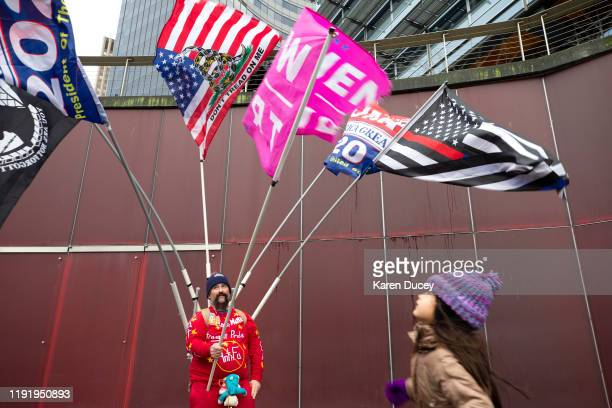 Michael Thompson of Bellingham Washington and his daughter Hannah Thompson attend a rally called United Against hate supporting gun rights hosted by...