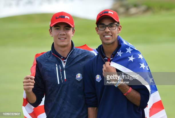 Michael Thorbjornsen of Team USA and Akshay Bhatia of Team USA pose on day one of the 2018 Junior Ryder Cup at Disneyland Paris on September 24 2018...