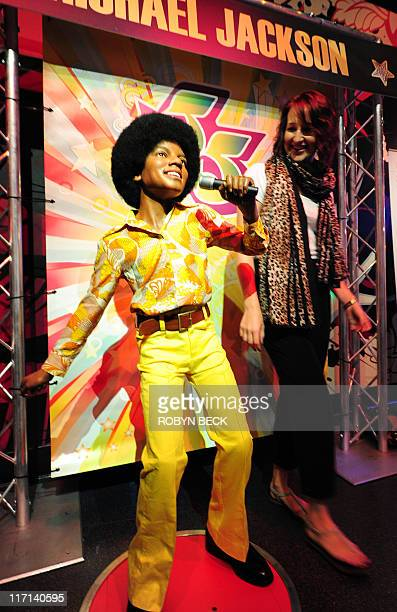 Michael Thurston Australian tourist Ashleigh Porteous looks over a wax figure of Michael Jackson June 22 2011 at a special exhibition marking the...