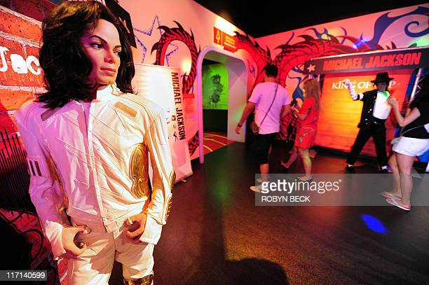 Michael Thurston Wax figures of Michael Jackson are on display June 22 2011 at a special exhibition marking the King of Pop's birthdate as well as...