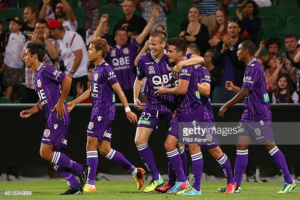 Michael Thwaite and Jamie Maclaren of the Glory celebrate a goal during the round seven A-League match between Perth Glory and the Central Coast...