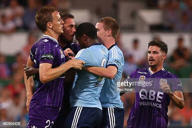 Michael Thwaite of the Glory and Aaron Calver of Sydney attempt to separate Dino Djulbic and Jacques Faty during the round 16 A-League match between...