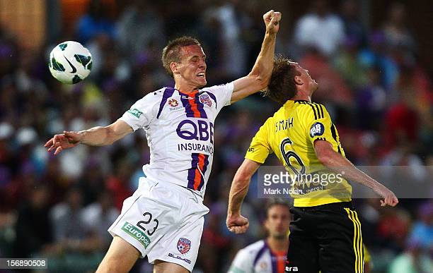 Michael Thwaite of the Glory and Alexander Smith of the Phoenix contest possession during the round eight A-League match between Perth Glory and...