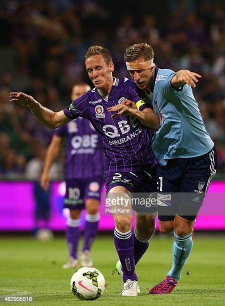 Michael Thwaite of the Glory and Marc Janko of Sydney contest for the ball during the round 16 A-League match between the Perth Glory and Sydney FC...