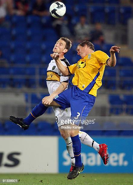 Michael Thwaite of United and Chris Greenacre of the Phoenix jump for a header during the round nine A-League match between Gold Coast United and the...