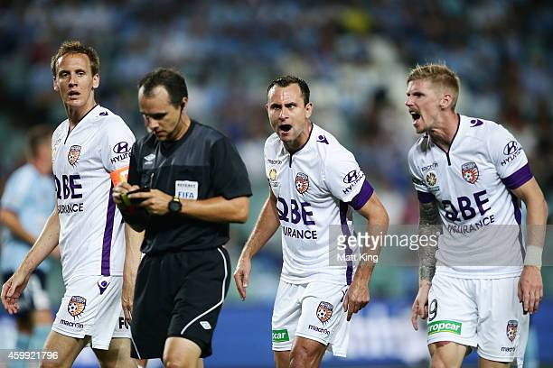 Michael Thwaite Richard Garcia and Andy Keogh of Perth Glory argue with the referee after a penalty was given whick led to the first goal during the...