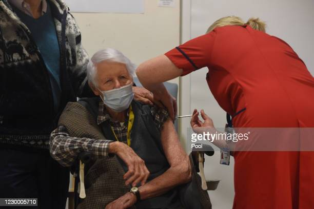Michael Tibbs, 99 is given the Pfizer/BioNtech covid-19 vaccine by Liz Rix, Chief Nurse at Queen Alexandra Hospital. Michael Tibbs is the first...
