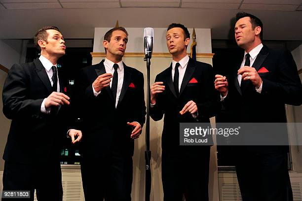 Michael Tierney Toby Allen Andrew Tierney and Phil Burton of the Australian vocal group Human Nature perform at The Australian ConsulateGeneral on...