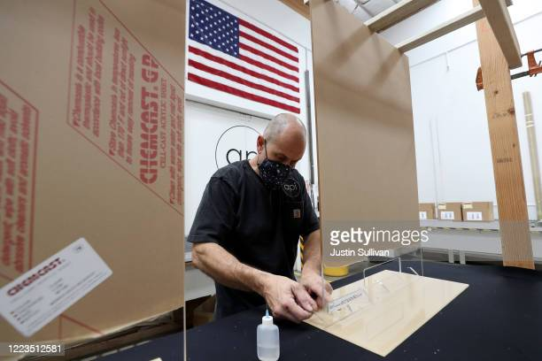 Michael Tolson with Architectural Plastics assembles acrylic sheets that will be used for social distancing guards for businesses on May 07 2020 in...